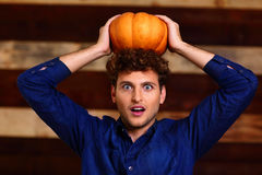 Surprised man with pumpkin on head Stock Photos