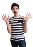Surprised man with raised hands Royalty Free Stock Photography