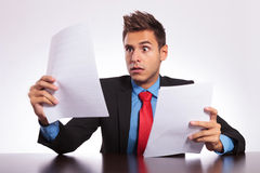 Surprised man reads letter at desk Stock Photos
