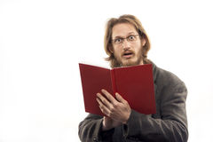 Surprised Man With Red Book. Young blond handsome man wearing glasses is very surprised after reading a book. Shot in studio. Isolated over white Stock Photography