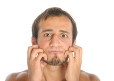 Surprised man scratch face. Isolated on white Royalty Free Stock Images