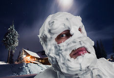 Surprised man with shaving foam on his head. Surprised strange man with shaving foam on his face and on his head at night Royalty Free Stock Photo