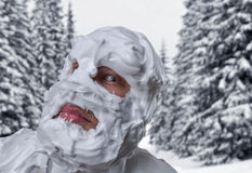 Surprised man with shaving foam on his head. Surprised strange man with shaving foam on his face and on his head over in winter forest Royalty Free Stock Image