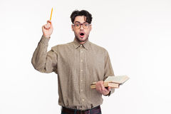 Surprised man standing with book Royalty Free Stock Photos