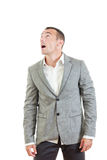 Surprised man in suit posing and looking up Royalty Free Stock Image