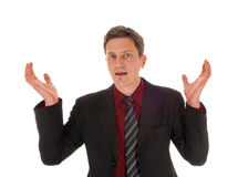 Surprised man in suit. stock photo