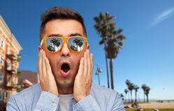 Surprised man in sunglasses over venice beach royalty free stock photography