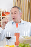 Surprised man tasting glass rose Stock Images