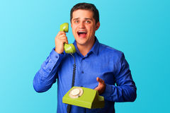 Surprised man with telephone Royalty Free Stock Photo