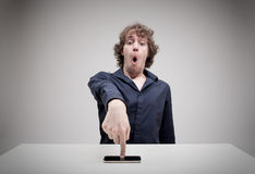Surprised man touching his smartphone screen Royalty Free Stock Images