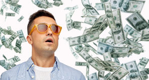 Surprised man under dollar money rain Stock Image