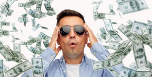 Surprised man under dollar money rain Royalty Free Stock Images