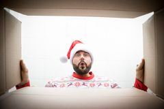 Free Surprised Man Unpack Christmas Gift Box Royalty Free Stock Photos - 160298498