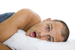 Surprised Man Waking Up Stock Photo