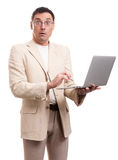 Surprised man wearing suit and glasses with laptop Royalty Free Stock Photo