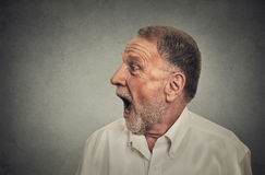 Surprised man with wide open mouth. Side profile surprised man with wide open mouth royalty free stock images