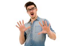 Surprised man. Young casual surprised man portrait in a white background Royalty Free Stock Photo