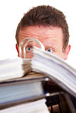 Surprised manager behind files Royalty Free Stock Images