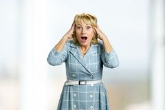 Surprised mature woman open mouth. Stock Photo