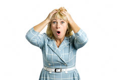 Surprised mature woman on white background. Royalty Free Stock Photos
