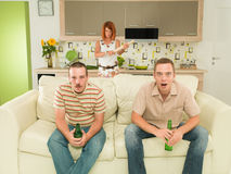 Surprised men watching tv Stock Photo