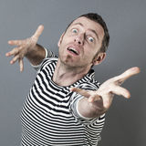 Surprised middle age man aiming with hope towards an inaccessible goal Royalty Free Stock Photography