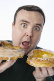 Surprised Middle Aged Man Holding Donuts Royalty Free Stock Image