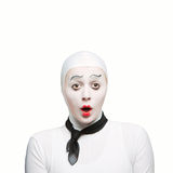 Surprised mime. Isolated on white protrait of a mime woman showing surprising exspression Stock Photo
