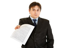 Surprised modern businessman giving document stock photography