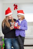 Surprised Mother And Daughter With Christmas Gift Stock Image
