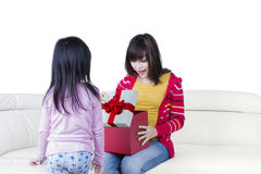 Surprised mother opens a presents box Royalty Free Stock Photos