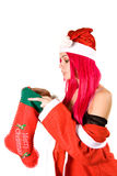 Surprised Mrs. Santa with Christmas stocking stock images