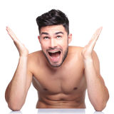 Surprised naked man looking up Stock Photo