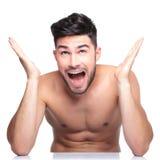 Surprised naked man looking up. Super surprised naked man looking up on white background Stock Photo