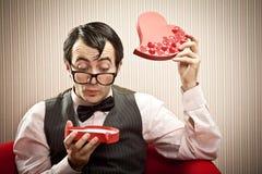 Surprised nerd man open chocolate box love gift.  Royalty Free Stock Photo