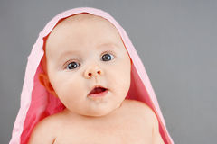 Surprised newborn with pink blanket Royalty Free Stock Photos