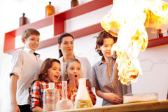 Surprised nice children looking at the fire Stock Image