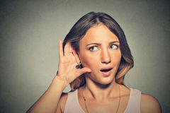 Surprised nosy woman hand to ear gesture carefully secretly listening Stock Photos