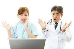 Surprised nurse and doctor Royalty Free Stock Image