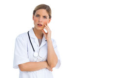 Surprised nurse with hand on her face Stock Photography