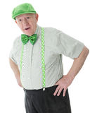 Surprised Old Irish Man. A surprised senior adult man looking happily surprised in his green hat, tie and shamrock-adorned suspenders.  On a white background Stock Photos