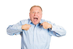 Surprised older man pointing at himself Stock Images