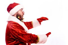 Young emotional bearded man in a Christmas costume. royalty free stock photography