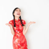 Surprised oriental girl in red qipao Stock Photography