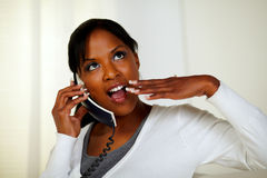 Surprised pensive woman speaking on phone Stock Photos