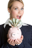 Surprised Piggybank Girl Stock Photo