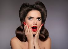 Surprised pin up girl holds cheeks by hand. Comic woman with cur Royalty Free Stock Photos