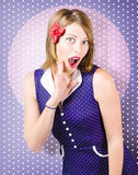 Surprised pin-up woman in purple polka dot dress Stock Photo