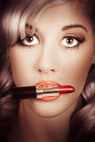 Surprised pinup girl with lipstick makeup in mouth Stock Image