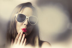 Surprised pinup girl in retro fashion makeup Royalty Free Stock Images